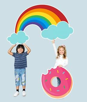 Crianças alegres com um arco-íris e um ícone de donut
