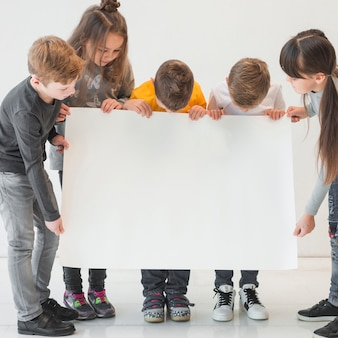 Crianças, segurando, em branco, sinal