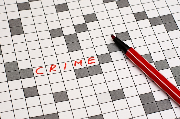 Crime. texto em palavras cruzadas. letras vermelhas