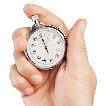 Cronômetro de close-up em mão humana, cronômetro