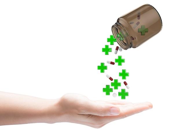 Cruz verde e comprimidos caindo da garrafa