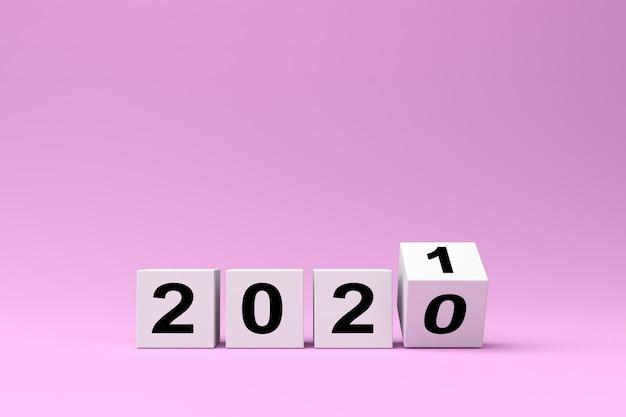 Cubos brancos com a inscrição 2020 são substituídos por 2021 em um fundo rosa, renderização 3d