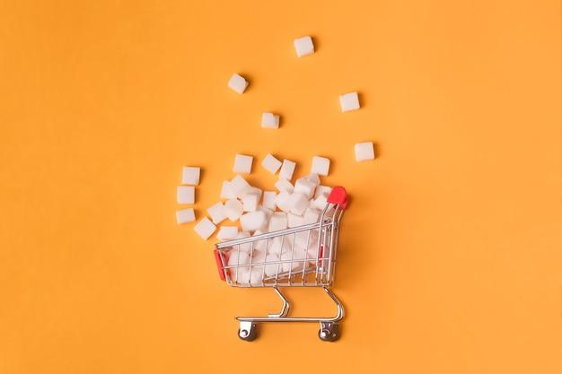 Cubos de açúcar no carrinho de compras