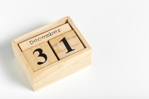Cubos de madeira com data. 31 de dezembro
