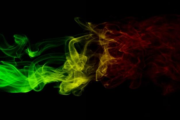 Curvas de fumaça de fundo abstrato e cores de reggae de onda