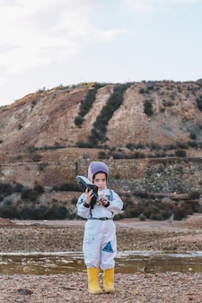 Cute girl playing spaceman