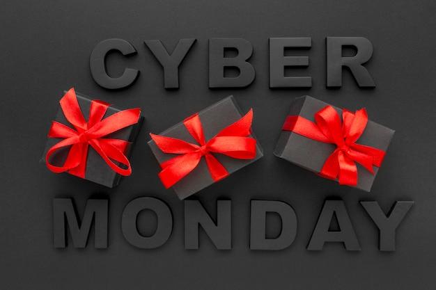 Cyber segunda-feira e caixas de presente com fita vermelha