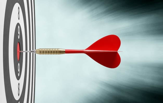 Dardo vermelho acertando o alvo no centro, conceito de sucesso