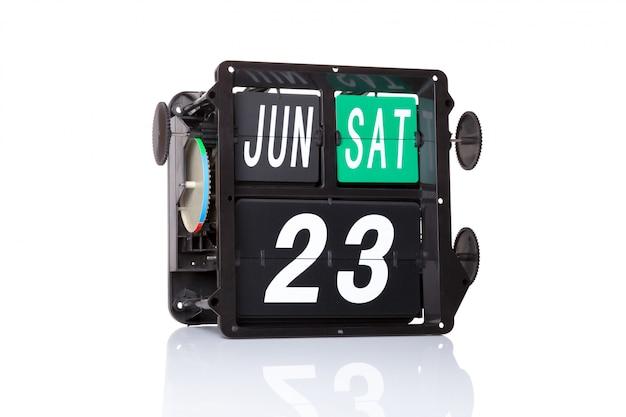 Data retro do calendário mecânico 23 de junho, no isolado dia do serviço público das nações unidas.