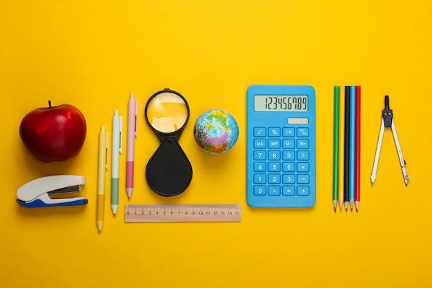 De volta à escola. escola e material de escritório em amarelo. educacional, conceito de estudo