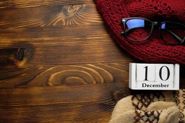 Décimo dia do mês de inverno dezembro em fundo de madeira Foto Premium