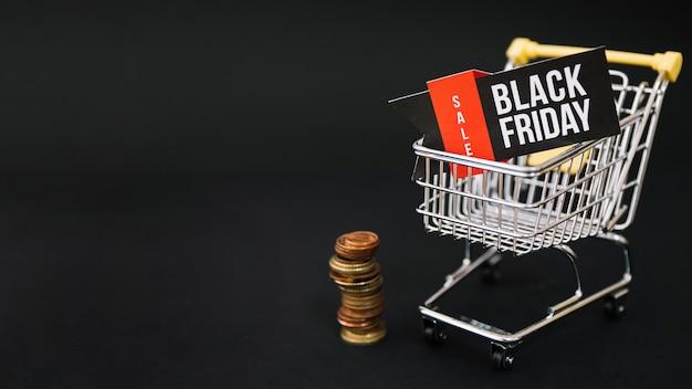 Decoração da sexta-feira preta com moedas e carrinho