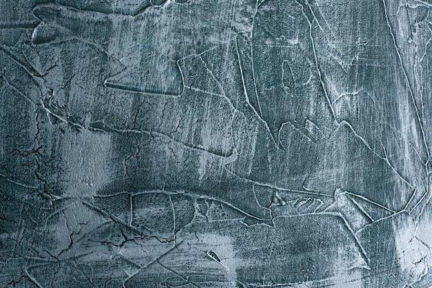 Decoração de fundo de gesso veneziano textura de pedra sem emenda de grunge azul dramático. decoração de cimento de concreto sujo rachado.