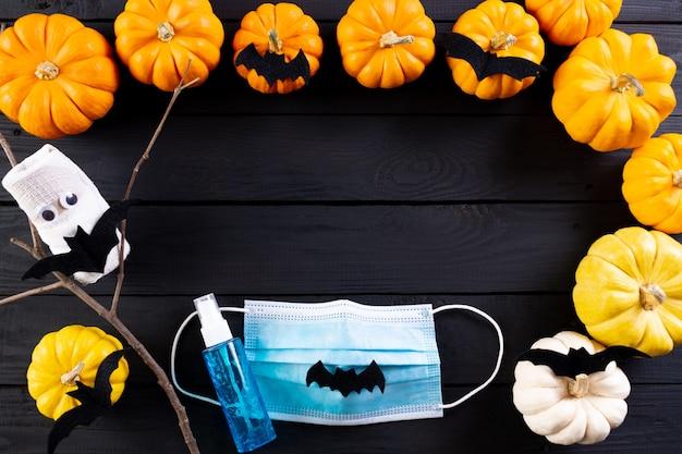 Decoração de halloween com abóboras e morcegos