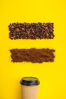 Decoração do grão de café e copo isolado em fundo amarelo, vista superior. comida vegetariana orgânica, variedade de alimentos, produtos ecológicos naturais, conceito de estilo de vida saudável