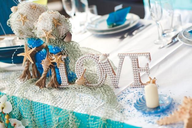 Decoração. estrela do mar. navio. cartas. casamento. banquete. mesa.