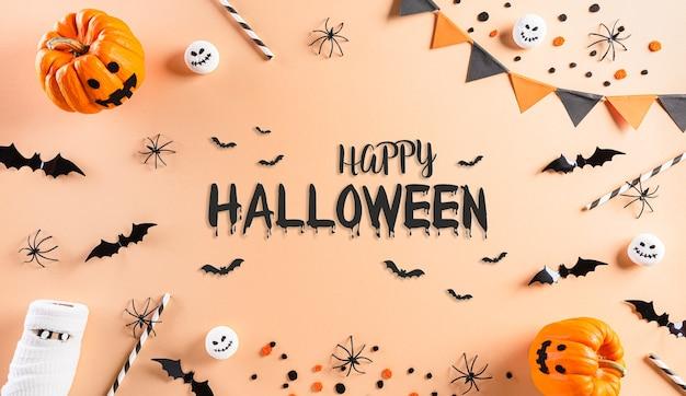 Decorações de halloween feitas de abóbora, morcegos de papel e aranhas pretas