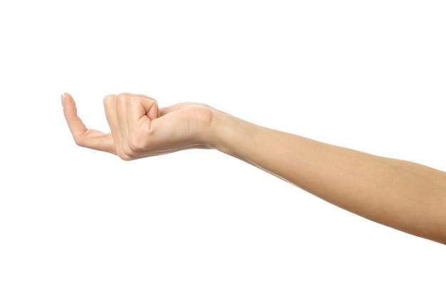 Dedo alcançando ou arranhando. mão da mulher com manicure francesa gesticulando isolado no fundo branco. parte da série