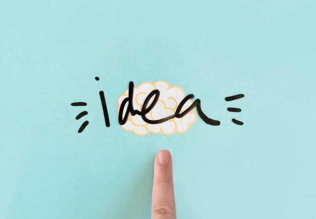 Dedo humano, apontar, em, cérebro, com, idéia, palavra