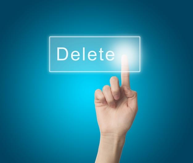 Dedo que pressiona a tecla delete