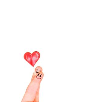 Dedos com coração em branco