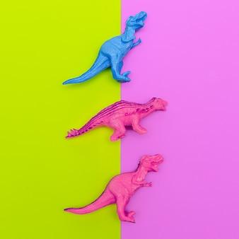 Definir brinquedos de dinossauros em um fundo colorido. flat lay minimal art