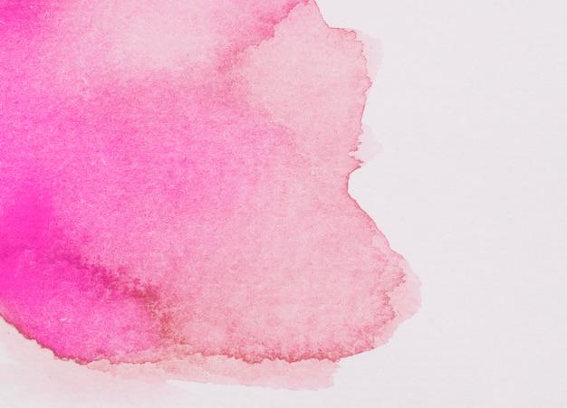 Derrame de tinta fúcsia e vermelha