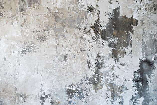 Descascar o fundo da parede de concreto