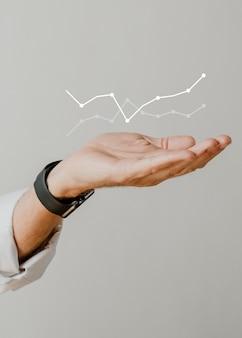 Desempenho de gráfico digital com sobreposição de mão de empresário