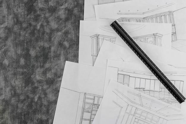 Desenho de designer de interiores de uma cozinha em um processo de desenho de projetos de design de interiores