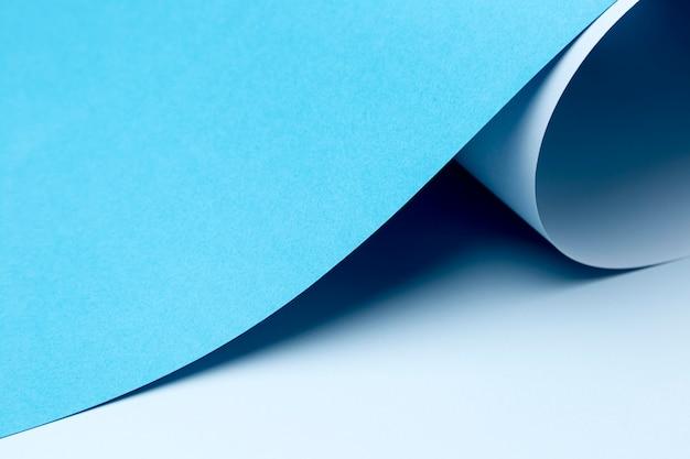 Desenho de fundo de folhas de papel azul