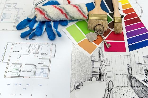 Desenho do arquiteto de plantas de apartamentos modernos com amostra de material de papel colorido na mesa criativa. desenho de casa para reforma
