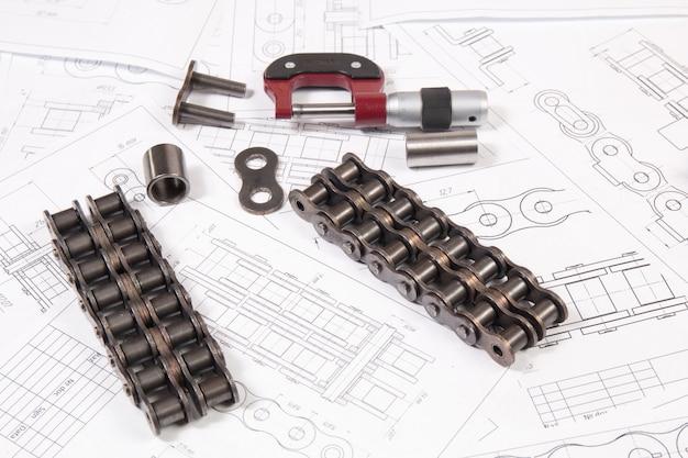 Desenhos de engenharia, acionamento por corrente de rolos e micrômetro de medição