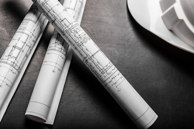 Desenhos de planejamento de construção em fundo preto