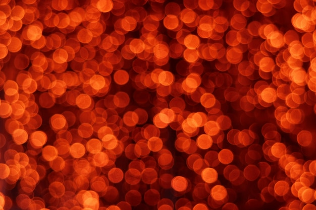 Desfocado luzes vermelhas bokeh no escuro para plano de fundo ou papel de parede