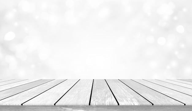 Desfocar o foco suave bokeh lâmpadas luz em fundo de cor branca e perspectiva de mesa de madeira envelhecida