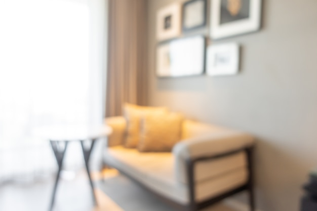 Desfoque a sala de estar com sofá e mesa