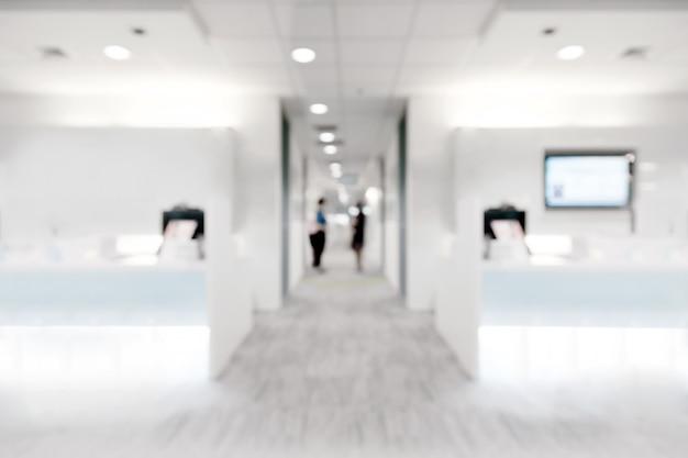 Desfoque abstrato dentro da clínica branca para o fundo