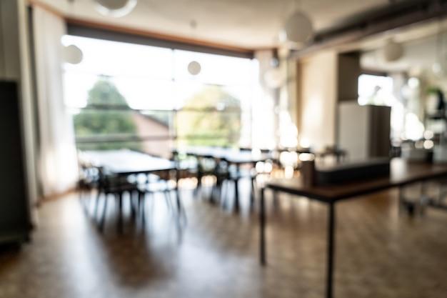 Desfoque abstrato e desfocado no restaurante do hotel para o fundo