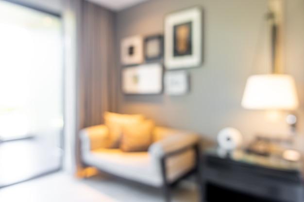 Desfoque abstrato e interior desfocado da sala de estar para o fundo