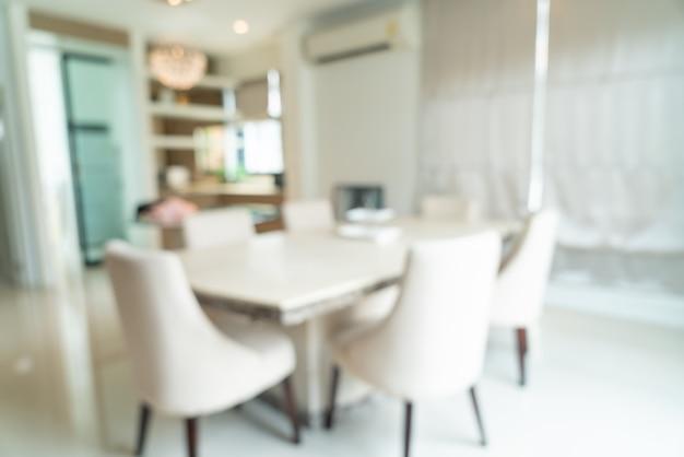 Desfoque abstrato e mesa de jantar desfocada na sala de jantar para segundo plano