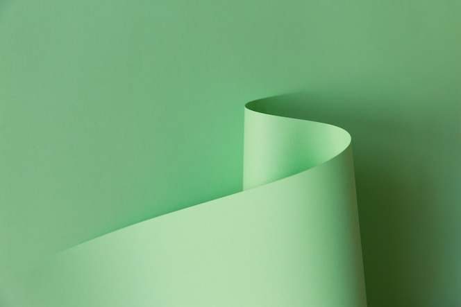 Design criativo abstrato de papel em forma de curva verde claro