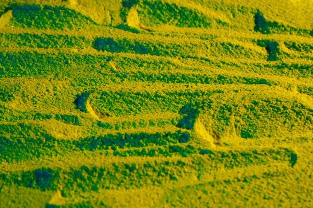 Design de areia com tons de verde colorido