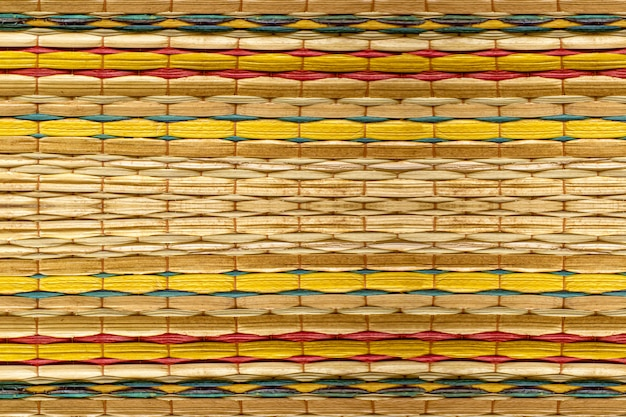 Design de fundo de padrões coloridos para esteiras de bambu