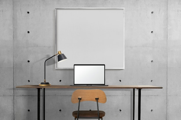 Design de interiores de escritórios domésticos industriais com moldura branca pendurada na parede