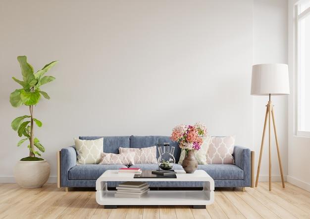 Design de interiores de uma sala de estar moderna, um sofá azul em uma parede branca vazia, renderização em 3d