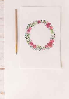 Design de moldura de flores pintada com aquarelas em papel