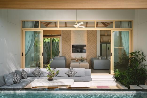 Design interior e exterior da luxuosa villa com piscina, casa e sala de estar