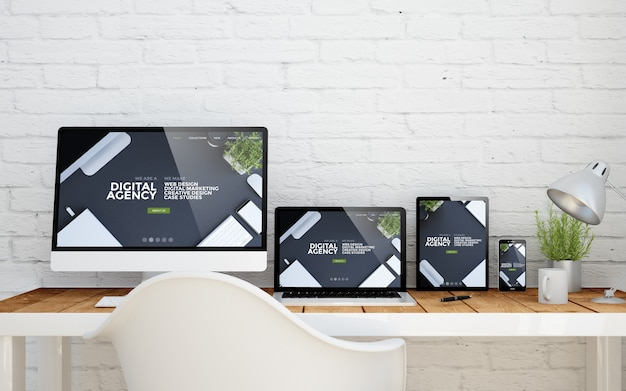 Desktop multidispositivo com site de agência digital nas telas