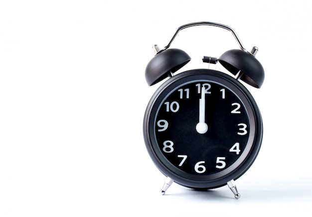 Despertador duplo sino preto sobre fundo branco